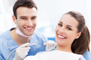 Male dentist and woman in dentist�¢�?�?s office