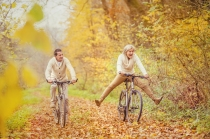 Active seniors ridding bike and having fun