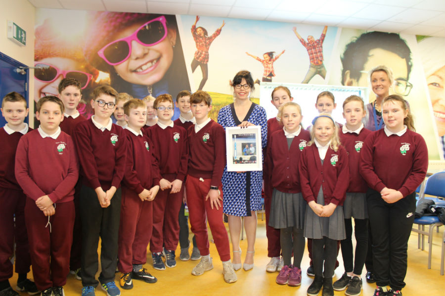 Gortskehy pupils present toothbrush to Maureen Walsh, DeCare Dental