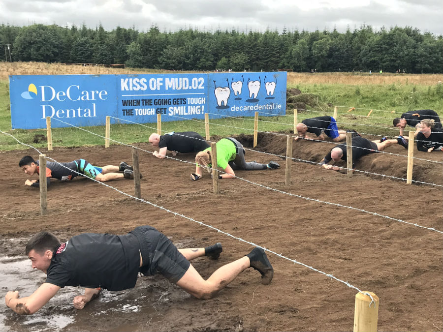 Tough Mudder 2018 Kiss of Mud obstacle sponsored by DeCare
